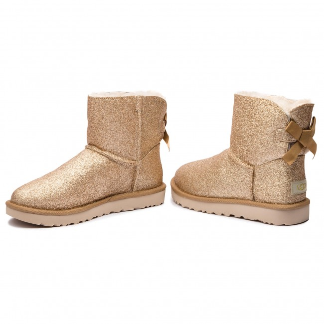 1c078a92050 Buty UGG - W Mini Bailey Bow Sparkle 1100053 W/Gold